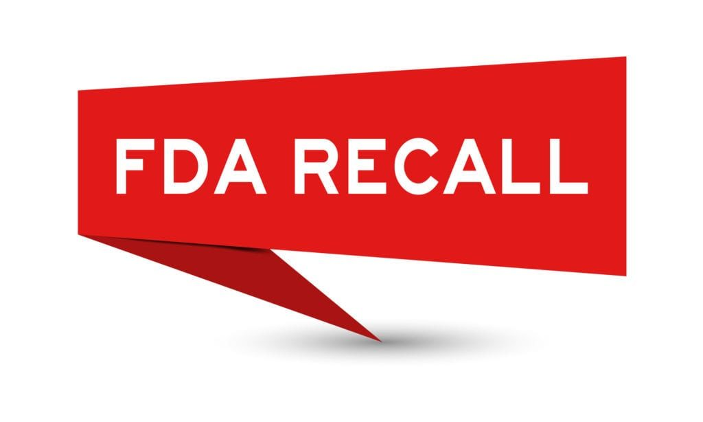 Red color paper speech banner with word FDA recall on white background Recall